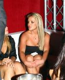 Britney Spears shows her cleavage and legs in short body hugging black dress at Ed Hardy Party in Hollywood