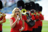 th_24992_celeb-city.org-The_Elder-Katherine_Jenkins_2009-07-08_-_sings_the_Welsh_national_anthem_before_the_game_359_122_41lo.jpg