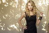 http://img239.imagevenue.com/loc411/th_29290_Taylor_Swift_-_Damian_Dovarganes_Photoshoot_054_122_411lo.jpg